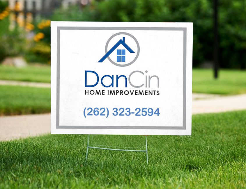 Home inprovement logo on sign in yard