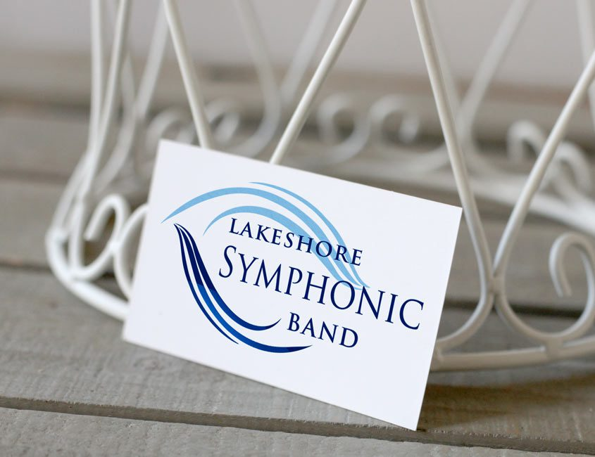 sumphony band logo on business card on table